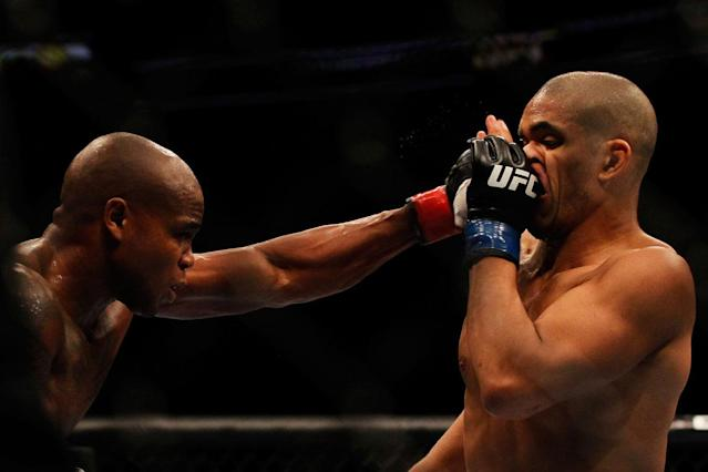 Marcus Brimage (L) punches Maximo Blanco during their featherweight bout for UFC 145 at Philips Arena on April 21, 2012 in Atlanta, Georgia.