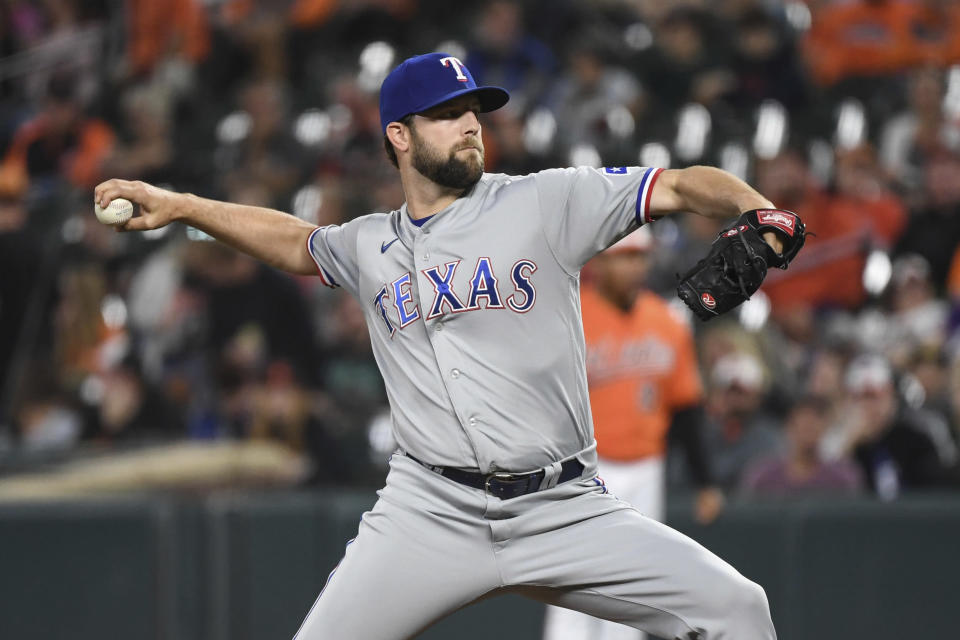 Texas Rangers starting pitcher Jordan Lyles (24) delivers a pitch during the first inning of a baseball game against the Baltimore Orioles, Saturday, Sept. 25, 2021, in Baltimore. (AP Photo/Terrance Williams)