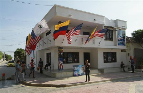 Colombian attorney Silvio Carrasquilla (R, blue striped shirt) decorates his house with U.S. and Colombian flags to welcome President Obama to the VI Summit of the Americas, in Turbaco, near Cartagena, Colombia, April 11, 2012.