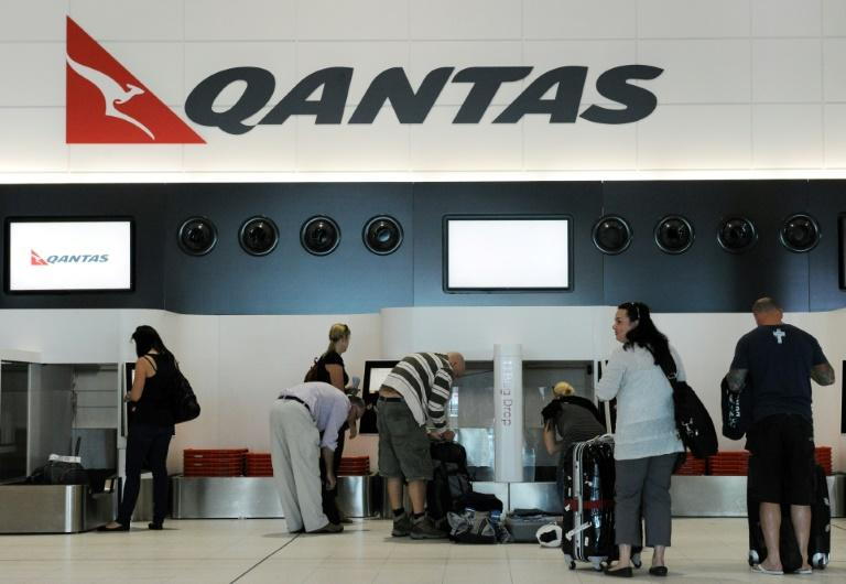 Qantas announced one of its Boeing 737NG planes was grounded after a crack was detected, and 32 others were being urgently inspected (AFP Photo/TORSTEN BLACKWOOD)