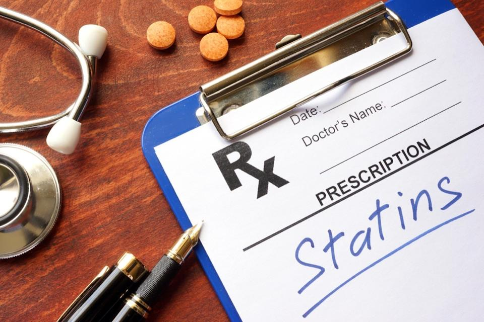 written prescription statins and stethoscope