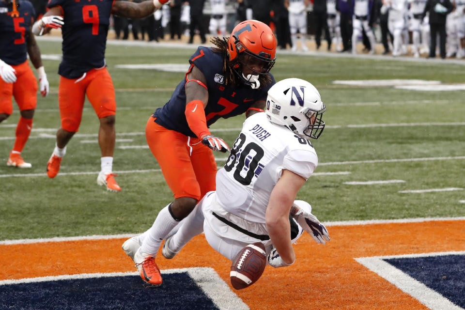 Northwestern tight end Trey Pugh (80) drops a pass in the end zone as Illinois defensive back Stanley Green (7) defends during the first half of an NCAA college football game Saturday, Nov. 30, 2019, in Champaign , Ill. (AP Photo/Charles Rex Arbogast)
