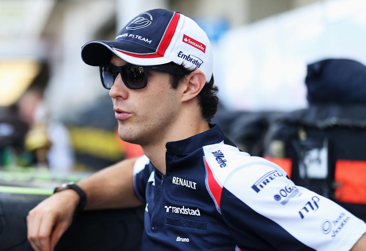 SAO PAULO, BRAZIL - NOVEMBER 22:  Bruno Senna of Brazil and Williams is interviewed in the paddock during previews for the Brazilian Formula One Grand Prix at the Autodromo Jose Carlos Pace on November 22, 2012 in Sao Paulo, Brazil.  (Photo by Mark Thompson/Getty Images)