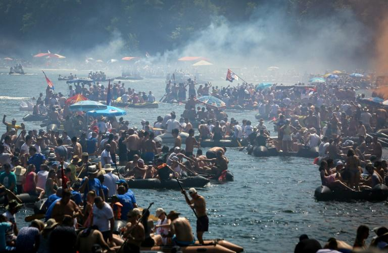 The annual celebration of exuberance and excessiveness starts with pallets of beer, often consumed before the improvised fleet casts off by the end of the morning on the Drina river (AFP Photo/OLIVER BUNIC)