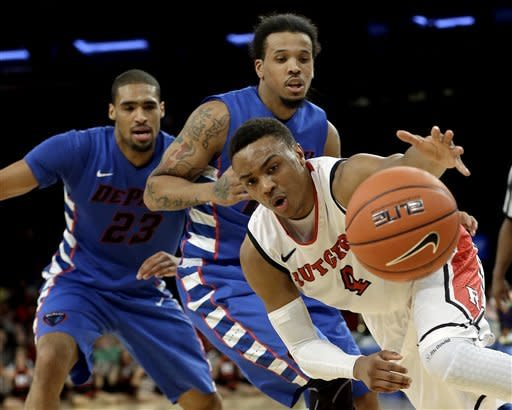 Rutgers' Myles Mack (4) chases down a loose ball as DePaul's Jamee Crockett, center, and Donnavan Kirk, left, watch during the first half of an NCAA college basketball game at the Big East Conference tournament, Tuesday, March 12, 2013, in New York. (AP Photo/Frank Franklin II)