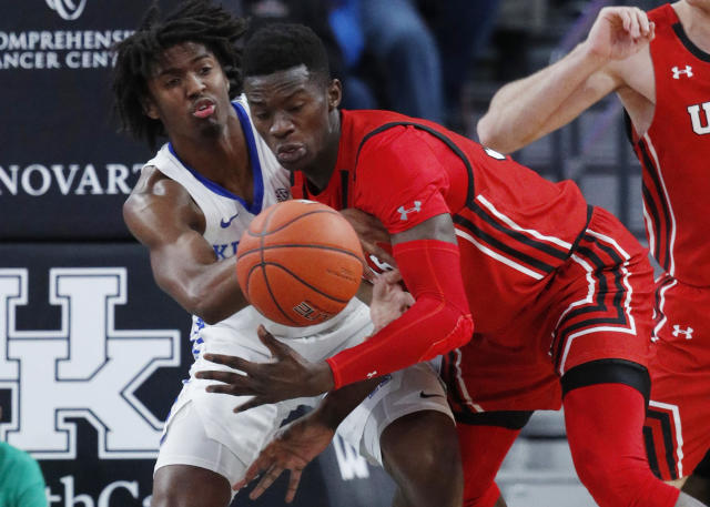 Kentucky's Tyrese Maxey, left, and Utah's Lahat Thioune vie for the ball during the first half of an NCAA college basketball game Wednesday, Dec. 18, 2019, in Las Vegas. (AP Photo/John Locher)