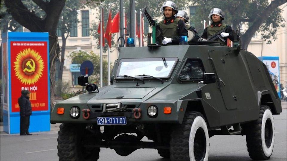 Soldiers with armoured vehicle