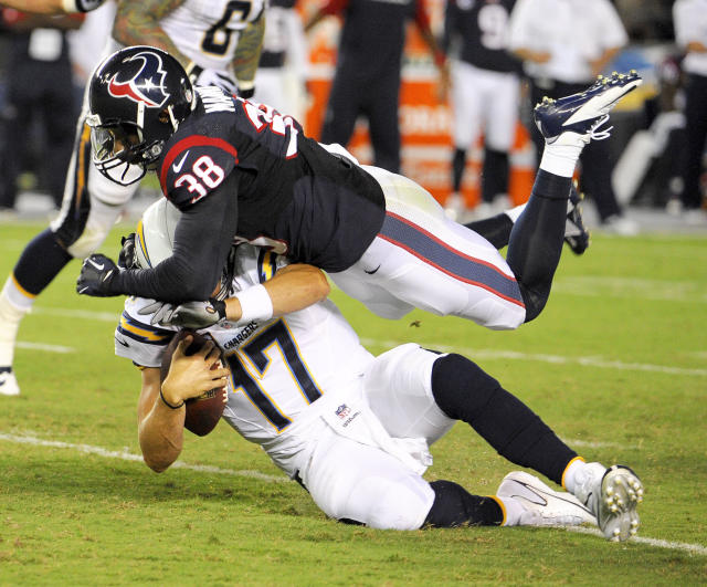 Houston Texans free safety Danieal Manning, top, sacks San Diego Chargers quarterback Philip Rivers during the first half of an NFL football game Monday, Sept. 9, 2013, in San Diego. (AP Photo/Denis Poroy)