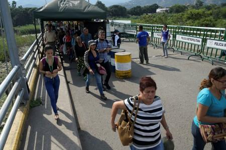 Venezuela partially opens border with Colombia that was shut in February