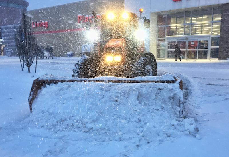 <p>A snow plow clears a parking lot outside of a Canadian Tire in Toronto on Jan. 28, 2019, during a record-setting day of snow in the city. Photo from Getty Images. </p>