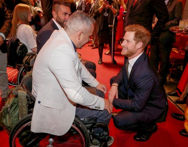 The Duke of Sussex speaks with guests during a reception to celebrate the fifth anniversary of the Invictus Games at the Guildhall in central London