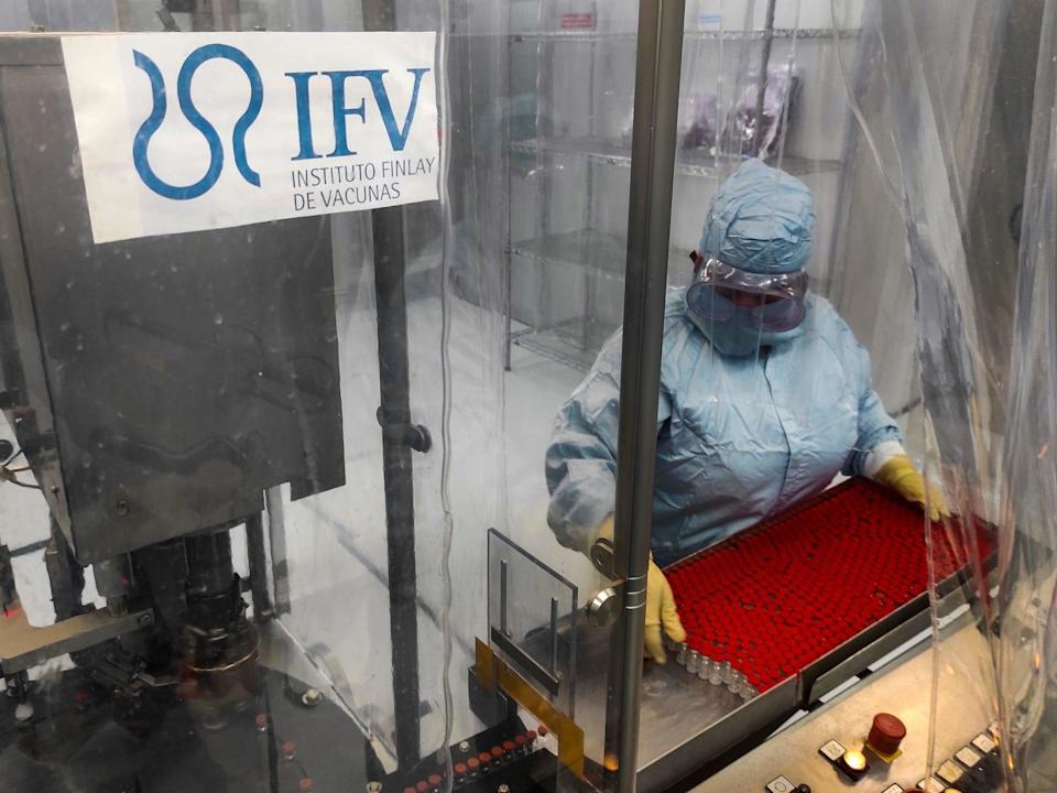 Technician Mayelin Mejias works at a vaccine processing plant at the Finlay Vaccine Institute in Havana, on January 20, 2021.