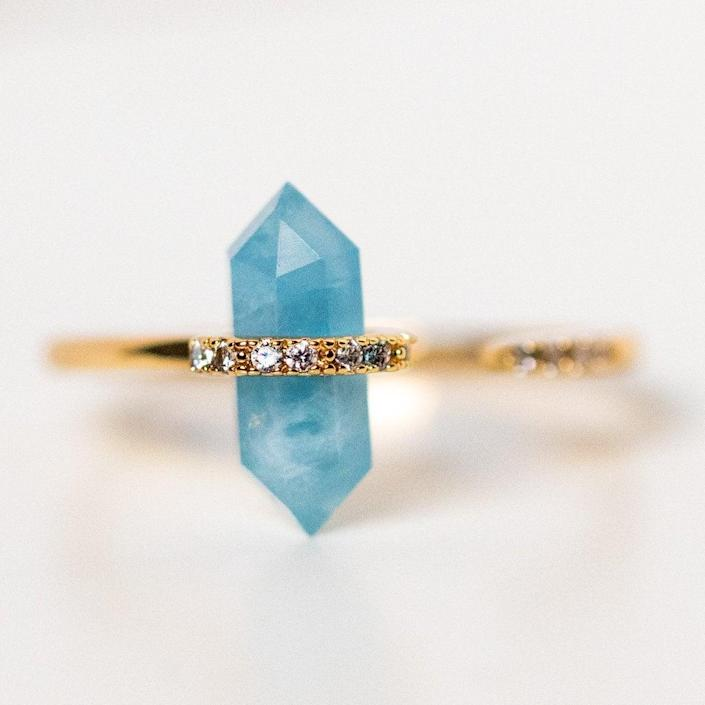 "<h2>March: Aquamarine<br></h2> <br> <strong>The Signs: Pisces & Aries<br></strong> <br>Aquamarine's name, says Oldershaw, ""derives from the Latin <em>aqua</em> for water and <em>mare</em> for the sea, and many superstitions and legends about the sea have been attached to the gemstone for many years. When it is immersed in water, the stone is practically invisible."" This transparency complements a Pisces' intuitive personality, and direct, no-bullshit Aries will appreciate the stone's clarity. <br> <br> <strong>Joy Dravecky</strong> Nouveau Ring with Aquamarine, $, available at <a href=""https://go.skimresources.com/?id=30283X879131&url=https%3A%2F%2Fwww.localeclectic.com%2Fproducts%2Fnouveau-ring-with-aquamarine%3Fvariant%3D32179657736270"" rel=""nofollow noopener"" target=""_blank"" data-ylk=""slk:Local Eclectic"" class=""link rapid-noclick-resp"">Local Eclectic</a>"