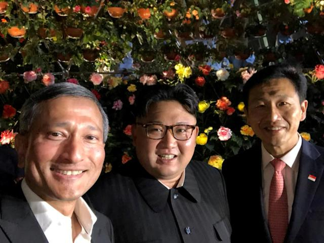 <p>Singapore's Foreign Minister Vivian Balakrishnan, North Korean leader Kim Jong Un, and Singapore's Education Minister Ong Ye Kung pose for a photo in Singapore June 11, 2018, in this photo obtained from social media. (Photo: Vivian Balakrishnan's Twitter page/via Reuters) </p>