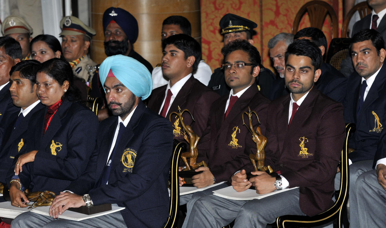 NEW DELHI, INDIA - AUGUST 31: National Sports Award winners during the presentation ceremony at Rashtrapati Bhavan on August 31, 2013 in New Delhi, India. National Sports Awards were presented to the country's top athletes and coaches with shooter Ronjan Sodhi getting the country's highest sporting honour Rajiv Gandhi Khel Ratna, while cricketer Virat Kohli was among the Arjuna awardees. (Photo by Mohd Zakir/Hindustan Times via Getty Images)