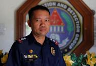 Police Superintendent Lito Patay, regional chief of the Criminal and Investigation Detection Group (CIDG), poses outside his office at Camp Olivas police camp in San Fernando, Pampanga in the Philippines December 11, 2017. REUTERS/Erik De Castro
