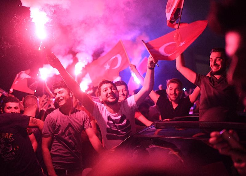 Crowds celebrated late into the night after Ekrem Imamoglu's win in the re-run mayoral vote (AFP Photo/BULENT KILIC)