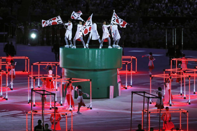 """<p>Dancers perform with flags that read """"Tokyo 2020"""" during the closing ceremony for the Summer Olympics in Rio de Janeiro, Brazil, Sunday, Aug. 21, 2016. Tokyo will host the next Summer Games in 2020. (AP Photo/Vincent Thian) </p>"""