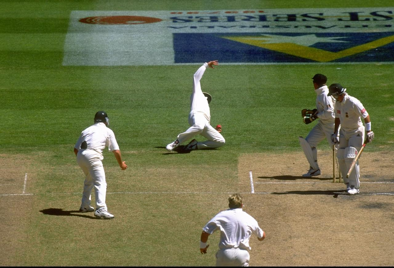 30 Dec 1997:  Mark Taylor (centre top) of Australia, fielding as first slip catches Adam Bacher (right) of South Africa, off the bowling of Shane Warne (centre bottom) during the first test match at the MCG in Melbourne, Australia. The match ended a draw. \ Mandatory Credit: Ben Radford /Allsport