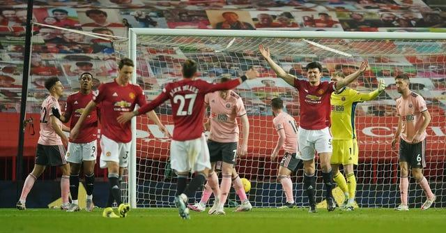 Harry Maguire, centre right, appeals after being penalised for a foul which denied Anthony Martial, second left, a goal