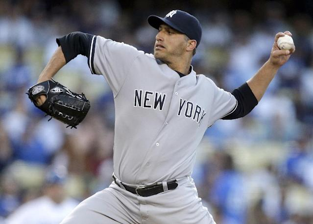 FILE - In this July 30, 2013, file photo, New York Yankees starting pitcher Andy Pettitte throws to the Los Angeles Dodgers during first inning of a baseball game in Los Angeles. Pettitte is retiring from baseball at the conclusion of the season, the Yankees announced on Friday, Sept. 20, 2013. (AP Photo/Chris Carlson, File)