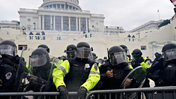 PHOTO: Police try to hold back protesters who gather to storm the Capitol and halt a joint session of the 117th Congress on Jan. 6, 2021, in Washington. (Kent Nishimura/Los Angeles Times via Getty Images)