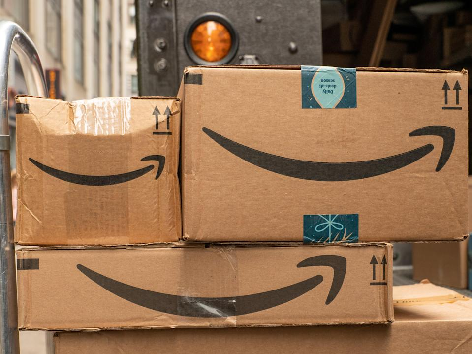 A hand-truck with Amazon packages waits to be delivered on 27 December 2019 in New York City (Getty Images)