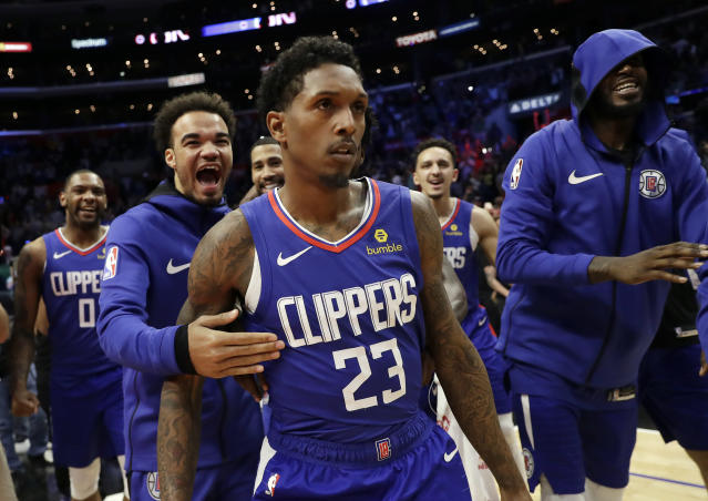 Los Angeles Clippers' Lou Williams (23) is mobbed by teammates after making the game-winning shot as time expired during the second half of an NBA basketball game against the Brooklyn Nets Sunday, March 17, 2019, in Los Angeles. (AP Photo/Marcio Jose Sanchez)