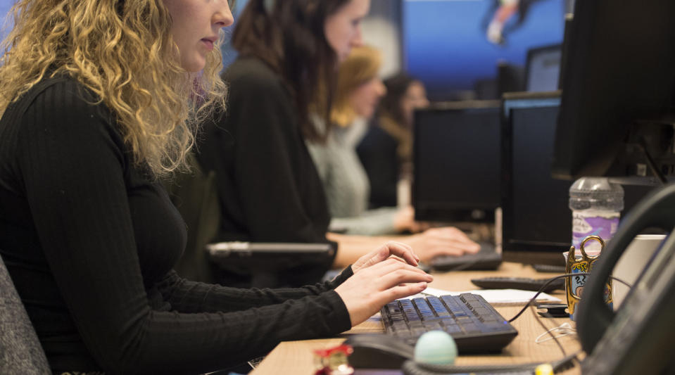 Embargoed to 0001 Thursday April 09 File photo dated 07/01/16 of office workers at their desks. Around half of workers fear they will lose their jobs or be forced to accept a lower salary because of the Covid-19 pandemic, a new study suggests.