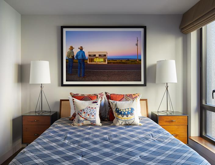 "<div class=""caption""> The guest bedroom's focal point is an arresting photograph by Grey Malin. The two animal pillows are from <a href=""https://www.westelm.com/"" rel=""nofollow noopener"" target=""_blank"" data-ylk=""slk:West Elm"" class=""link rapid-noclick-resp"">West Elm</a>: ""I think we had those fellows at our very first place together, years and years ago,"" Mikita says. ""So, they've made it through the test of time."" The bed linens are from <a href=""https://www.threadexperiment.com/"" rel=""nofollow noopener"" target=""_blank"" data-ylk=""slk:Thread Experiment"" class=""link rapid-noclick-resp"">Thread Experiment</a>, with side tables from <a href=""https://www.aerostudios.com/"" rel=""nofollow noopener"" target=""_blank"" data-ylk=""slk:Aero Studio"" class=""link rapid-noclick-resp"">Aero Studio</a> and table lamps from <a href=""https://www.circalighting.com/"" rel=""nofollow noopener"" target=""_blank"" data-ylk=""slk:Circa Lighting"" class=""link rapid-noclick-resp"">Circa Lighting</a>. </div>"