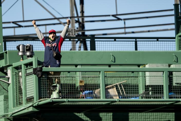 BOSTON, MA - SEPTEMBER 20: An unidentified man wearing a Boston Red Sox jersey cheers from the center field camera platform unauthorized, causing a delay in the eighth inning of a game between the Boston Red Sox and the New York Yankees on September 20, 2020 at Fenway Park in Boston, Massachusetts. (Photo by Billie Weiss/Boston Red Sox/Getty Images)