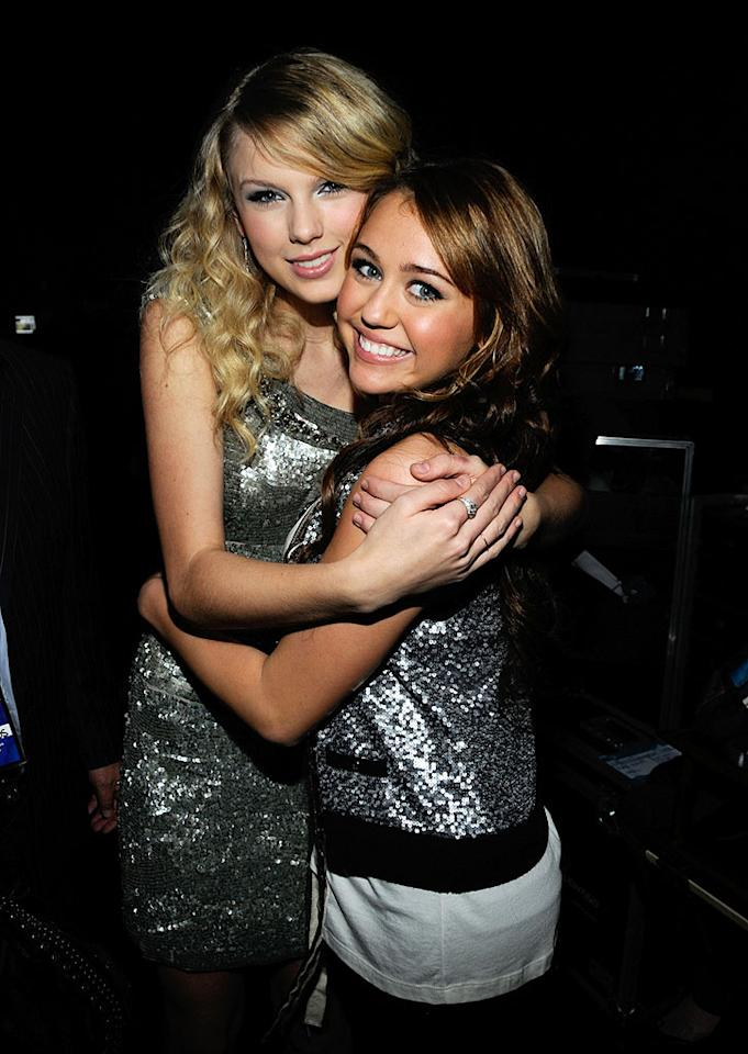 "BFFs Taylor Swift and Miley Cyrus share a hug backstage at the 2009 American Music Awards. The two teen singers also share the same taste in men: Taylor cast Miley's beau Justin Gaston in her ""Love Story"" video. Kevin Mazur/<a href=""http://www.wireimage.com"" target=""new"">WireImage.com</a> - November 23, 2008"