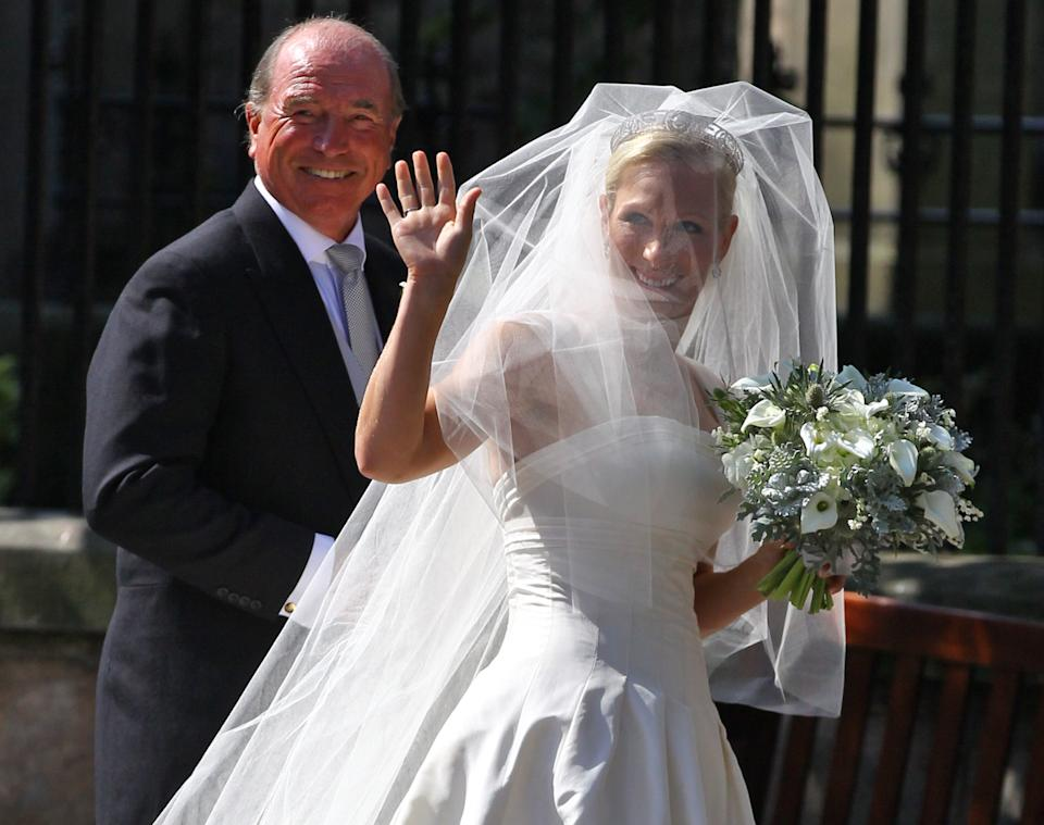 EDINBURGH, SCOTLAND - JULY 30:  Captain Mark Phillips and Zara Phillips arrive for the Royal wedding of Zara Phillips and Mike Tindall at Canongate Kirk on July 30, 2011 in Edinburgh, Scotland. The Queen's granddaughter Zara Phillips will marry England rugby player Mike Tindall today at Canongate Kirk. Many royals are expected to attend including the Duke and Duchess of Cambridge.  (Photo by Jeff J Mitchell/Getty Images)