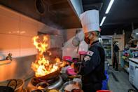 For many in the Asia's densely populated cities, where living space is at a premium, eating daily from cheap restaurants or food stalls is more affordable and viable than cooking at home (AFP/Anthony WALLACE)