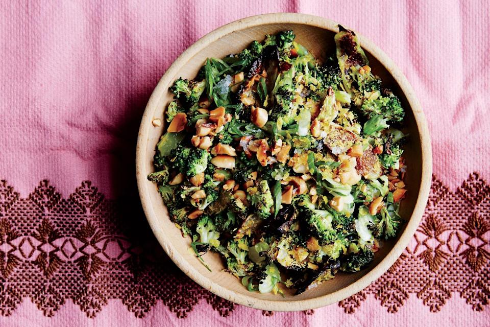 """Broccoli stems get roasted while the florets get charred in a pan for a satisfying combination of textures in this side dish. Crunchy peanuts seal the deal. <a href=""""https://www.epicurious.com/recipes/food/views/roasted-and-charred-broccoli-with-peanuts-51260420?mbid=synd_yahoo_rss"""" rel=""""nofollow noopener"""" target=""""_blank"""" data-ylk=""""slk:See recipe."""" class=""""link rapid-noclick-resp"""">See recipe.</a>"""