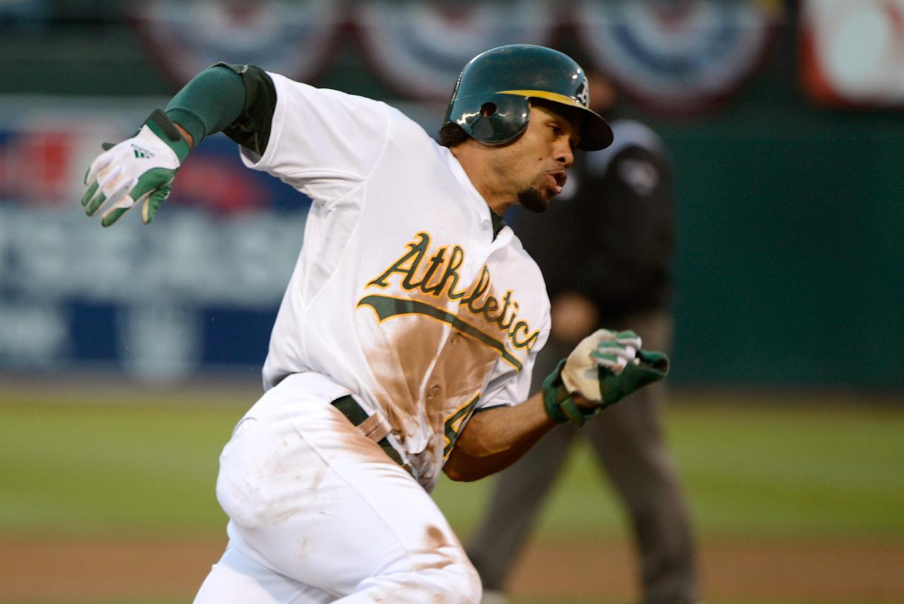 OAKLAND, CA - OCTOBER 09:  Coco Crisp #4 of the Oakland Athletics rounds third on his way to scoring after a single by Yoenis Cespedes #52 of the Oakland Athletics in the first inning against the Detroit Tigers during Game Three of the American League Division Series at Oakland-Alameda County Coliseum on October 9, 2012 in Oakland, California.  (Photo by Thearon W. Henderson/Getty Images)