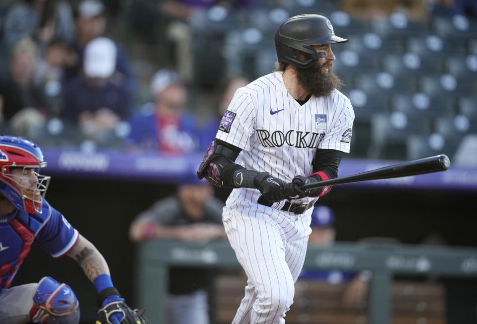 Colorado Rockies' Charlie Blackmon breaks from the batter's box after singling off Texas Rangers starting pitcher Jordan Lyles during the second inning of a baseball game Wednesday, June 2, 2021, in Denver. (AP Photo/David Zalubowski)