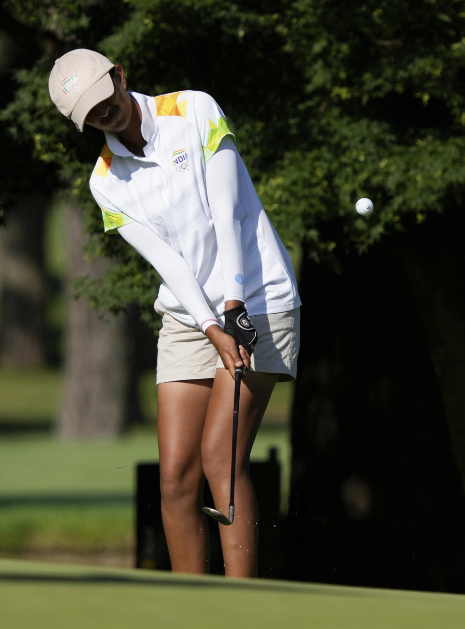 Aditi Ashok, of India, chips onto the second green during the second round of the women's golf event at the 2020 Summer Olympics, Thursday, Aug. 5, 2021, at the Kasumigaseki Country Club in Kawagoe, Japan. (AP Photo/Andy Wong)