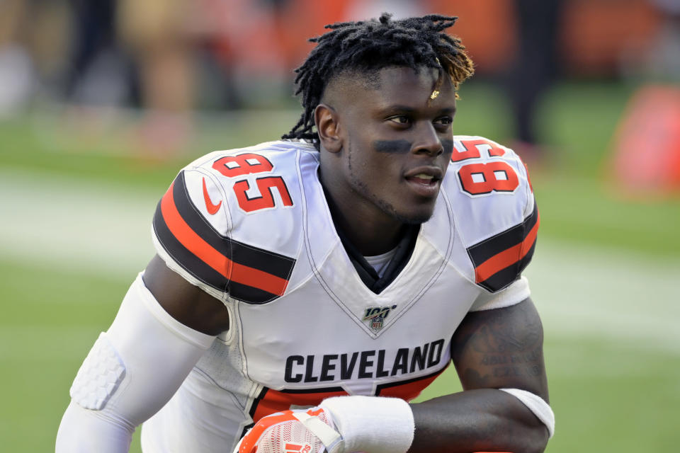 FILE - In this Aug. 8, 2019, file photo,Cleveland Browns tight end David Njoku kneels on the field before an NFL preseason football game against the Washington Redskins, in Cleveland. The Browns could be missing several starters Sunday night when they face the defending NFC champion Los Angeles Rams. Tight end David Njoku (wrist), linebacker Christian Kirksey (chest), right tackle Chris Hubbard (foot) and safeties Damarious Randall (concussion) and Morgan Burnett (leg) missed practice Thursday, Sept. 19, 2019. (AP Photo/David Richard, File)