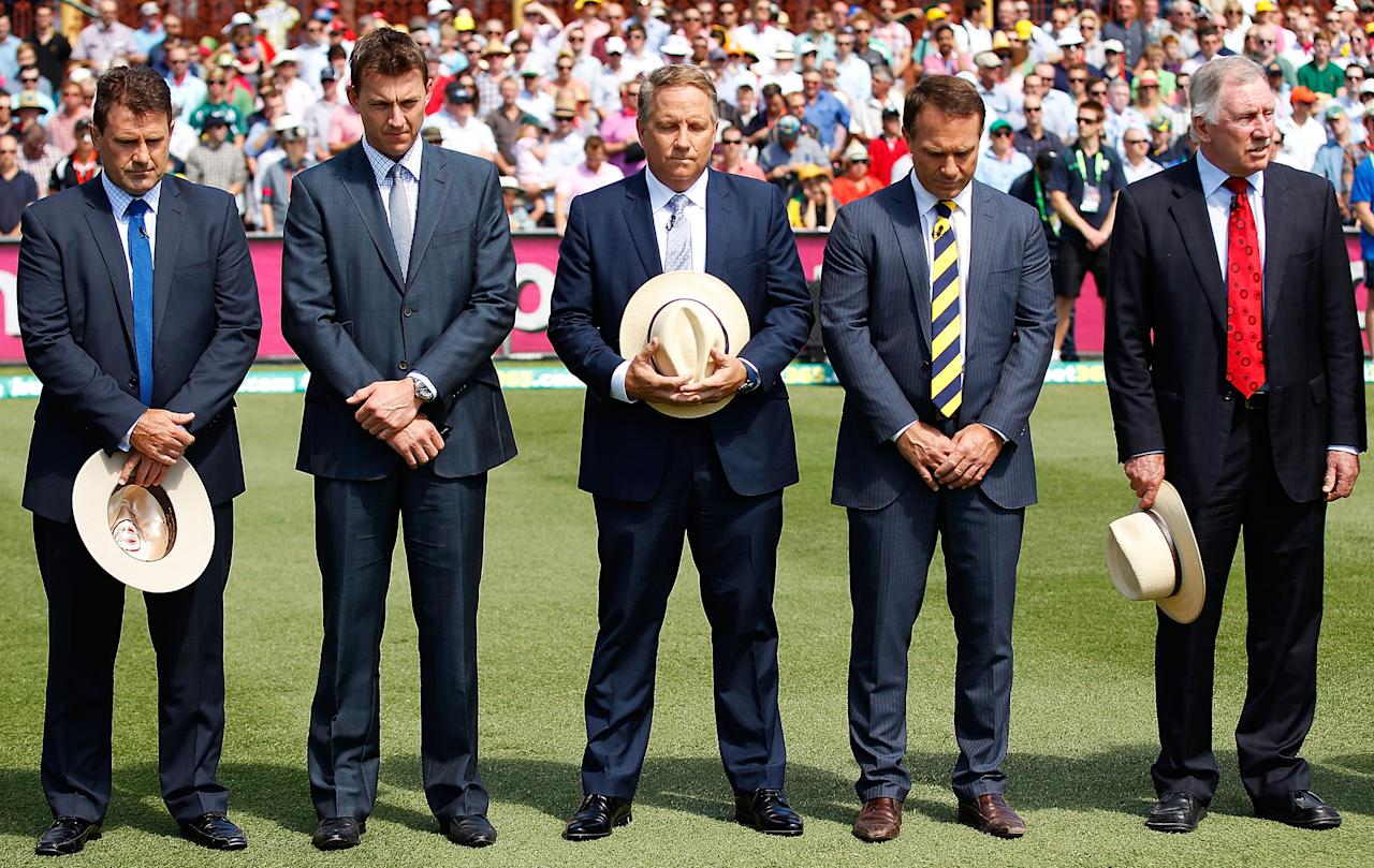 SYDNEY, AUSTRALIA - JANUARY 03:  Channel Nine cricket commentators Mark Taylor, Brett Lee, Ian Healy, Michael Slater and Ian Chappell stand in silence to mark the passing of former England Test crickter and Channel Nine cricket commentator, Tony Greig prior to day one of the Third Test match between Australia and Sri Lanka at the Sydney Cricket Ground on January 3, 2013 in Sydney, Australia.  (Photo by Brendon Thorne/Getty Images)