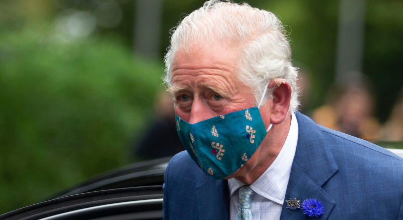 Britain's Prince Charles, Prince of Wales wears a face mask or covering due to the COVID-19 pandemic as he exits a car upon arrival to visit the Ulster Museum in Belfast on September 30, 2020. (Photo by Ian Vogler / POOL / AFP) (Photo by IAN VOGLER/POOL/AFP via Getty Images)