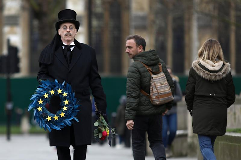 A man carries an EU themed wreath at Parliament Square (Reuters)