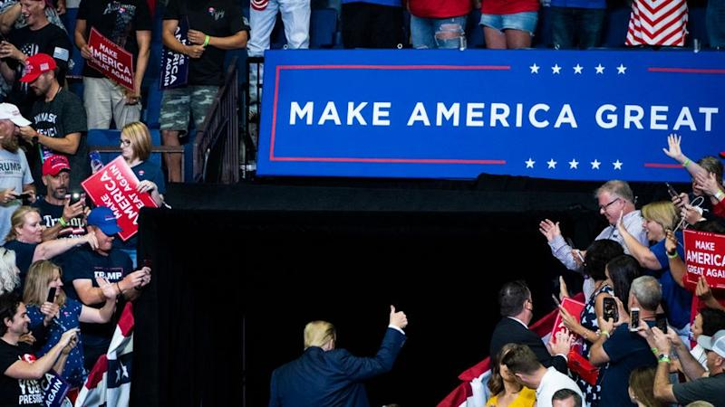 Few Trump supporters wore masks at his Tulsa rally