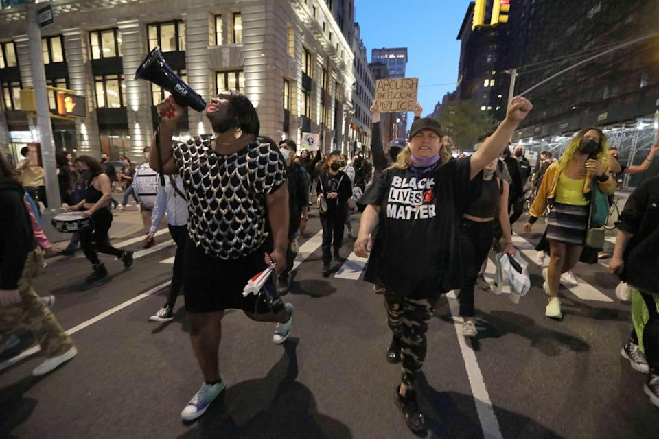 Black Lives Matter demonstrators march through Manhattan on April 20, 2021, hours after a jury in Minneapolis convicted Derek Chauvin of three counts of murder and manslaughter in the death of George Floyd.