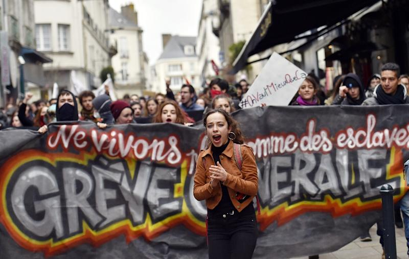 Young people demonstrate on March 9, 2016 in Nantes, western France, as part of a nationwide day of protest against proposed labour reforms