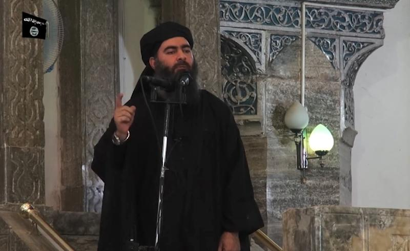 This file photo taken on July 5, 2014 shows an grab from a propaganda video released by Al-Furqan media group allegedly showing the leader of the Islamic State jihadist group, Abu Bakr al-Baghdadi, addressing Muslims at a mosque in Iraq's Mosul (AFP Photo/-)