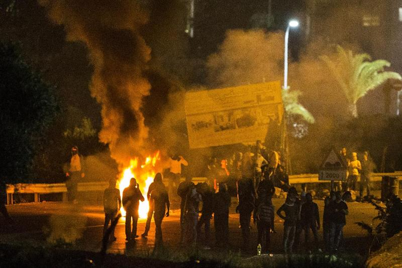 Arab Israeli youths burn tires in the town of Kfar Kana, in northern Israel on November 10, 2014 as tension mounts amid the fatal stabbing of two young Israelis (AFP Photo/Jack Guez)