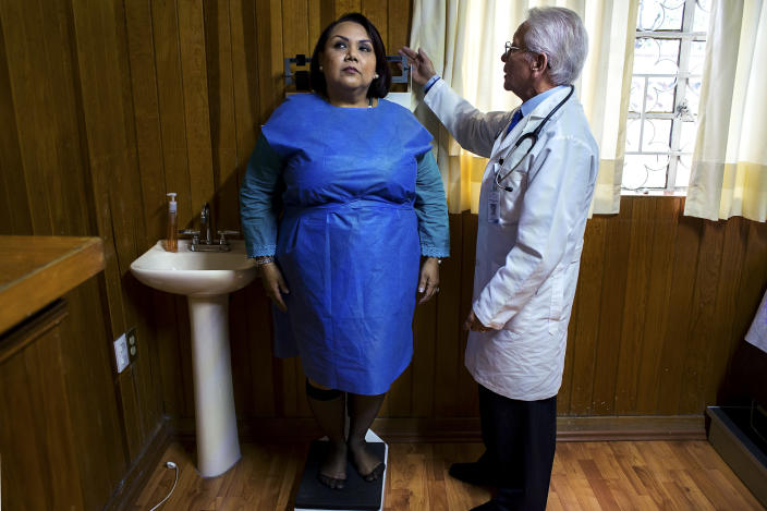 """<p>Giosefina Gaytan Caballero, 51, during a visit with Dr. J.M. Miranda at the clinic """"Fundacion RH Pharma"""" in Mexico City. Caballero suffers from rheumatoid arthritis, and its symptoms are aggravated by her obesity. (Photograph by Silvia Landi) </p>"""