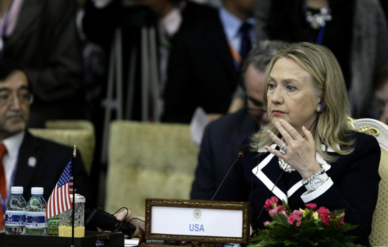 U.S. Secretary of State Hillary Rodham Clinton, right, attends the 2nd East Asia Summit (EAS) Foreign Ministers' Meeting in Phnom Penh, Cambodia, Thursday, July 12, 2012. (AP Photo/Heng Sinith)