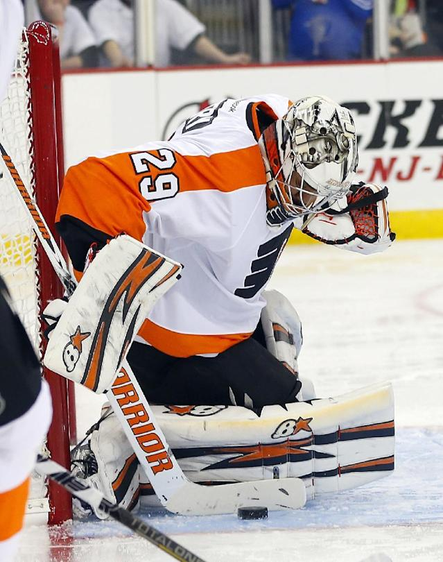 Philadelphia Flyers' goalie Ray Emery makes a stick save against the New Jersey Devils during the second period of an NHL hockey game in Newark, N.J., Saturday, Nov. 2, 2013. (AP Photo/Rich Schultz)